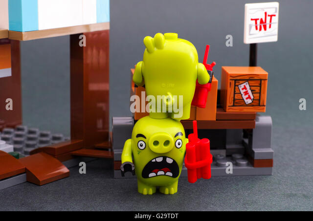Tambov, Russian Federation - April 14, 2016 Lego Angry Birds. Two bad piggies standing on each other and getting - Stock Image