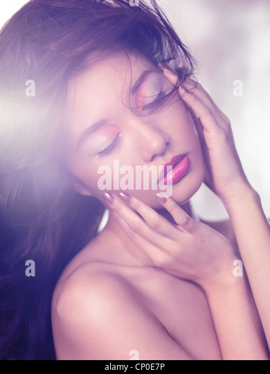 Beauty portrait of an asian woman sensual face with artistic makeup in soft light - Stock-Bilder