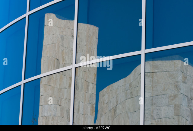 An outdoor view of a building reflected in a window at the J. Paul Getty Museum in Los Angeles, CA. - Stock Image