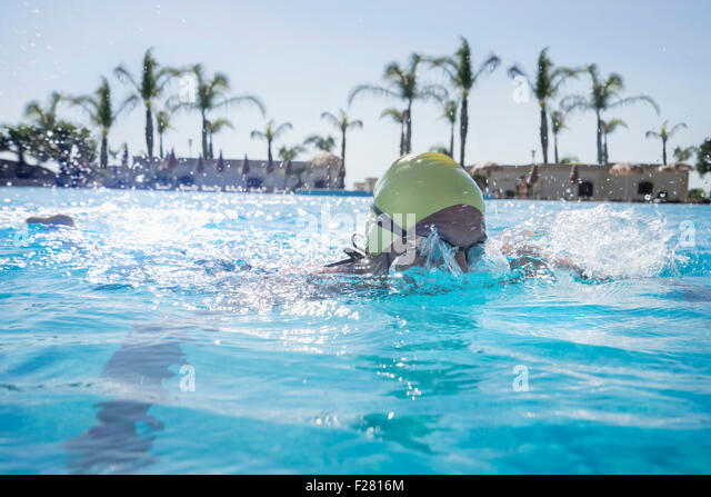 Mature woman swimming in swimming pool, Puglia, Italy - Stock-Bilder