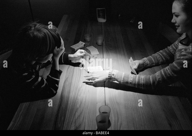 A girl and a boy playing card Sweden - Stock Image