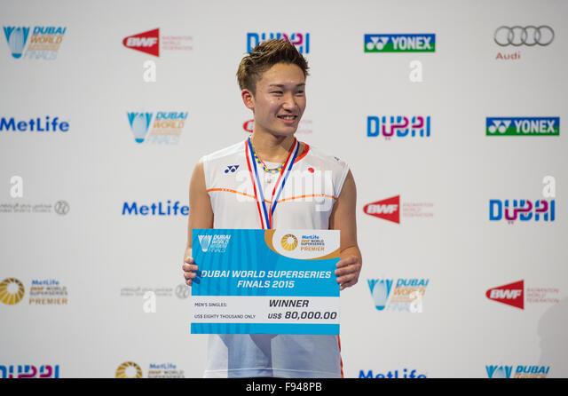 DUBAI, UAE, 13th Dec 2015. Kento Momota at the presentation ceremony after winning the men's singles title at - Stock Image