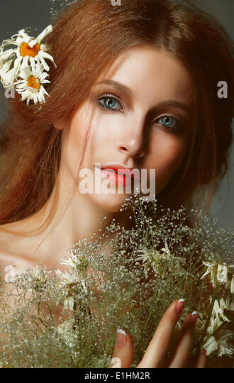 Pure Beauty. Auburn Girl holding Bouquet of Wildflowers. Tenderness - Stock Image