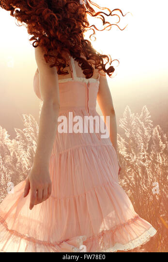 Curly woman turning away - Stock Image