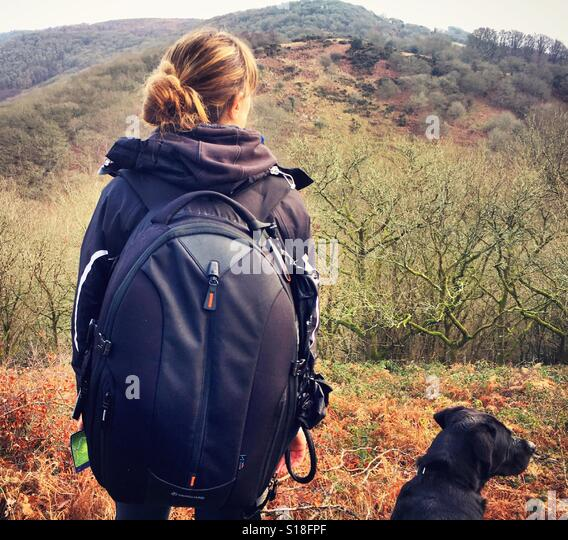 Woman and her dog on hike - Stock-Bilder