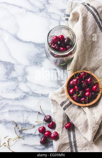Cherries in a bowl and jar - Stock Image