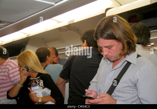 Buenos Aires Argentina Jorge Newbery Airport airfield AEP LAN Airlines aircraft jet Airbus 320 cabin Hispanic man - Stock Image