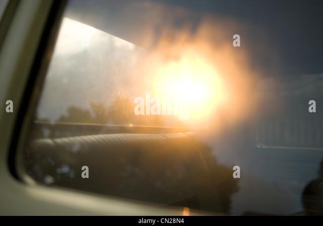 Sunlight reflecting on car window - Stock Image