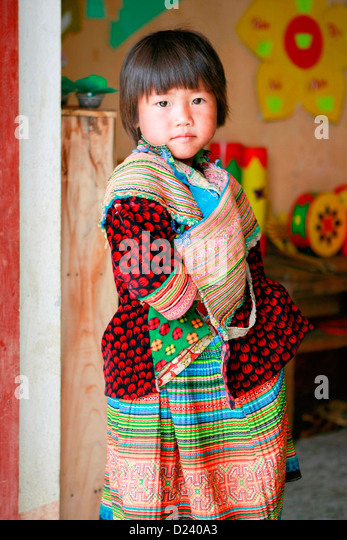 A young Flower H'mong girl at a village school near Bac Ha, North Vietnam, South East Asia. - Stock-Bilder