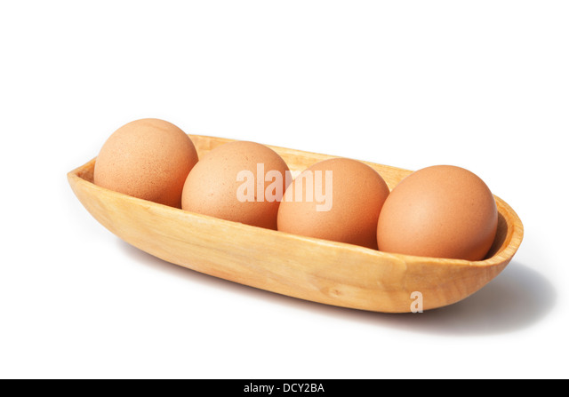 Four Free Range Eggs in a Wooden Bowl With a White Background UK - Stock Image