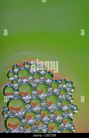 lots of bubbles forming beautiful intricate pattern with space for text - Stock Image