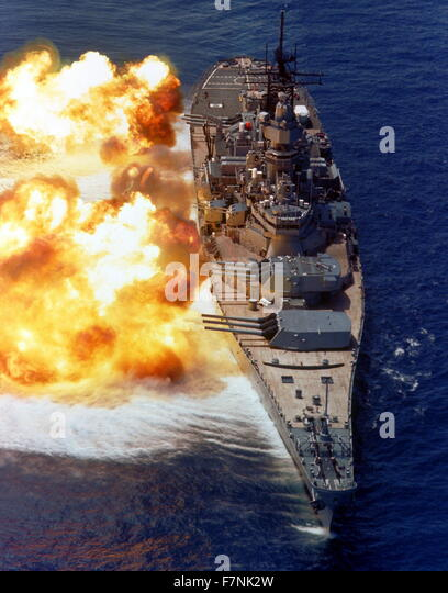 USS Iowa firing a full broadside during a gunnery demonstration, 15 Aug 1984 - Stock Image
