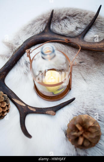 Rustic lantern with yellow candle burning - Stock Image