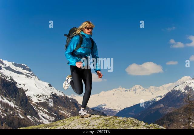 Girl jogging on top of the World. - Stock-Bilder