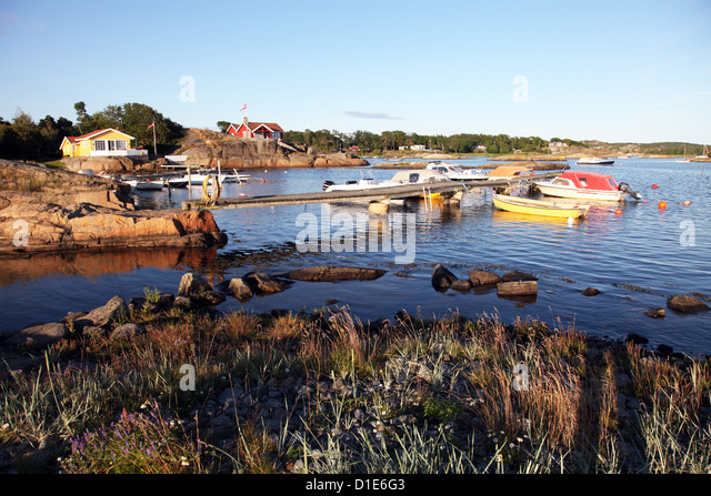 Summer cabins and boats near Larvik, Vestfold, South Norway, Norway, Scandinavia, Europe - Stock Image