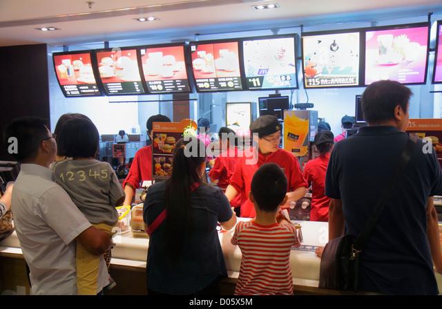 Shanghai China Huangpu District Yuyuan Garden Fuyou Road McDonald's fast food restaurant counter menu ordering - Stock Image