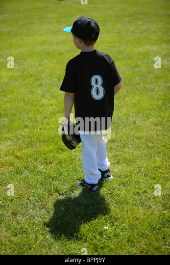 Young boy playing baseball - Stock Image