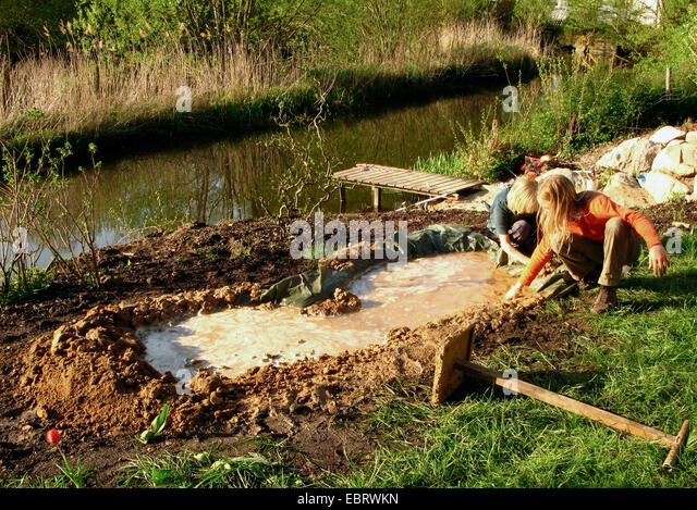 Loam soil stock photos loam soil stock images alamy for Small pond construction
