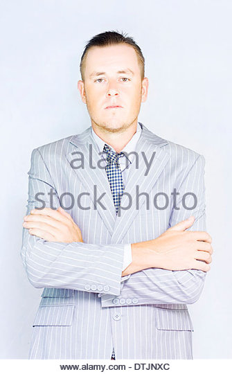 Young businessman front view as he receives a dressing down from the company vice president. - Stock Image