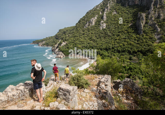 Male hikers at coast, Olympos, Lycian way, Turkey - Stock Image