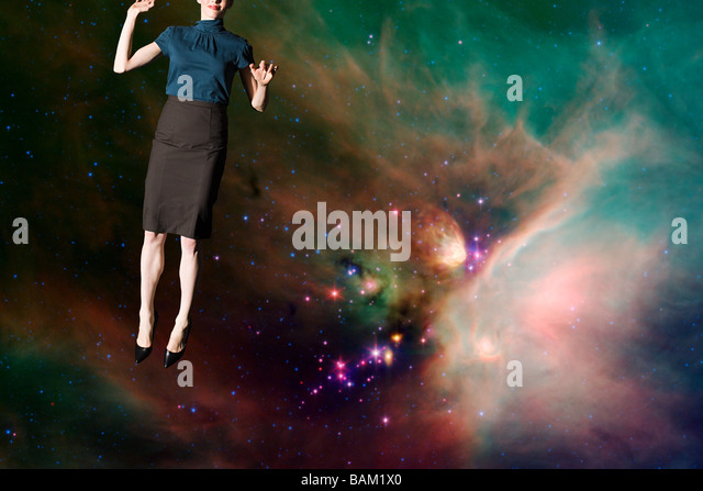 Businesswoman in outer space - Stock Image