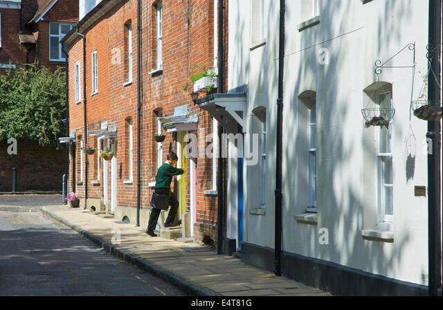 Schoolboy entering house in Farnham, Surrey, England UK - Stock Image