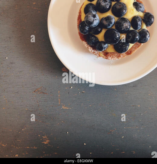 Milan, Lombardia, Italy Blueberry Tarte On Grey Table - Stock Image