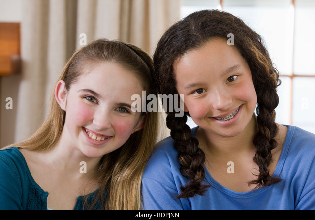 Portrait of two girls smiling - Stock Image