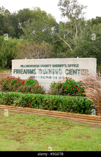 Sign indicating the firearms training center for the Hillsborough County Sheriff's Office.  The center is located - Stock Image