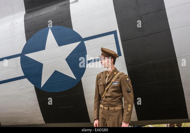 The Victory Show 2014, Leicester, England, UK. Air Cadet standing near American Douglas C.47 Dakota airplane. - Stock Image