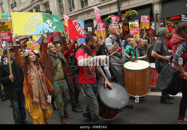 London, UK. March 18, 2017: Protestors make a sound with their drums as they participate in the Stand Up To Racism - Stock Image