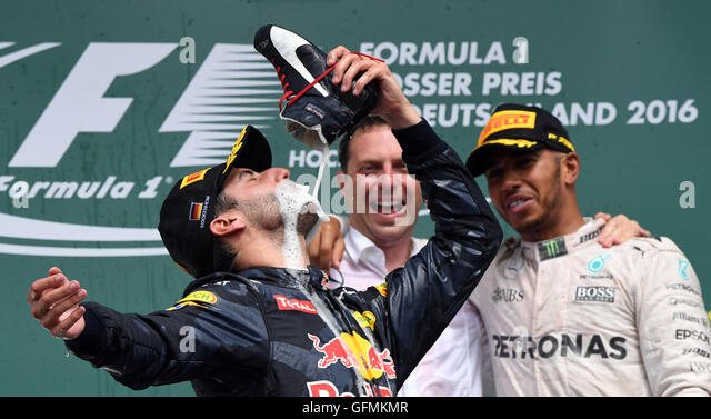 Hockenheim, Germany. 31st July, 2016. Second placing Daniel Ricciardo from Red Bull Racing drinks champagne from - Stock-Bilder