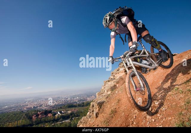 Spain, Sierra Nevada, Granada, man mountain biking downhill - Stock Image