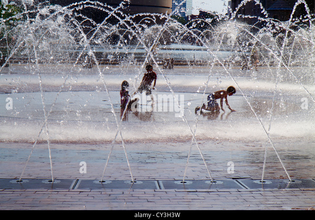 Massachusetts Boston Christian Science Plaza Children's Fountain water playing boy girl silhouette - Stock Image