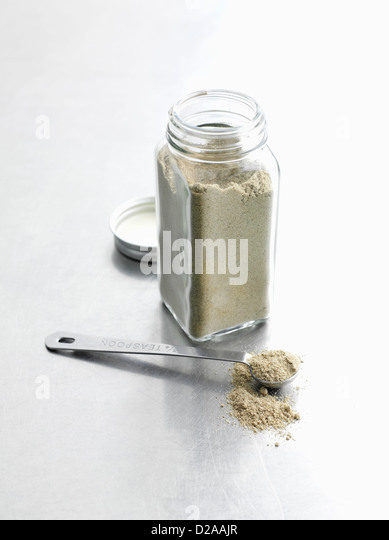 Jar of dried spices - Stock Image