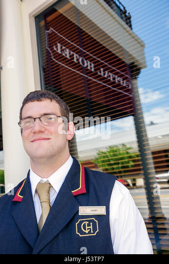 Little Rock Arkansas Markham Street Capital Hotel man young uniform porter job employment greet historic hotel hospitality - Stock Image