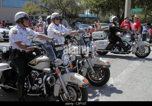 Florida Plant City South Evers Street Florida Strawberry Festival Grand Parade sheriff police motorcycle man men - Stock Image