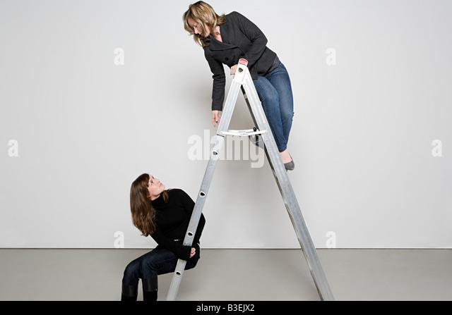 Two women on step ladder - Stock Image