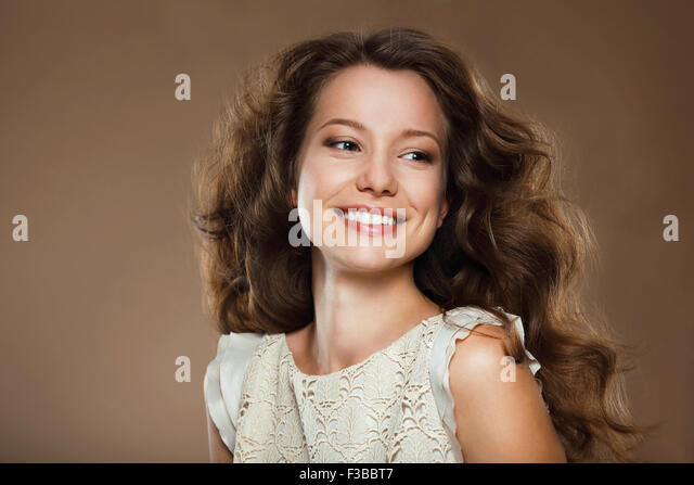 Toothy Smile. Portrait of Happy Lovely Brunette - Stock Image