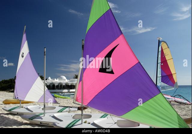 Anguilla beach Sailboats colorful sails on beach caribbean at Cap Juluca Resort caribbean iconic scenic beach landscape - Stock Image