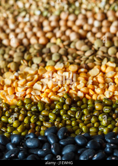 Cereals background: chickpeas, peas, lentils, green buckwheat, black beans - Stock Image