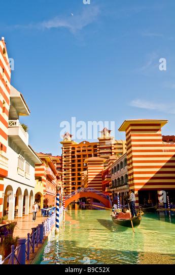 Porto Marina Resort and Spa fantasy hotel venetian canal gondola Egypt Mediterranean North Coast El Alamein Alexandria - Stock Image