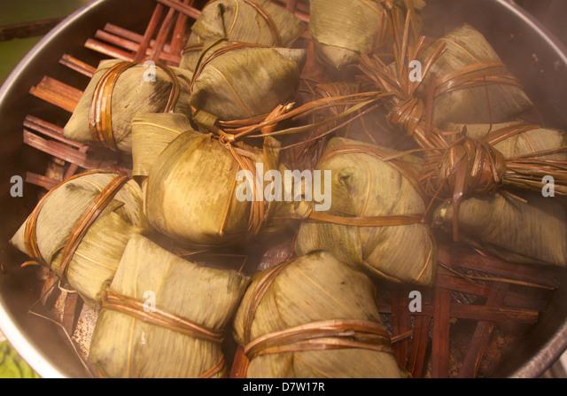 Steamed rice dumpling in lotus leaf, Hong Kong, China - Stock Image