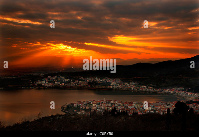 Sunset in Kastoria town and lake Orestias (or 'Orestiada'), Macedonia, Greece - Stock Image