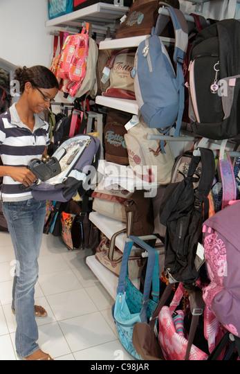 Curaçao Netherlands Antilles Dutch Willemstad Otrobanda Rif Fort shopping store business backpack clerk pricing - Stock Image