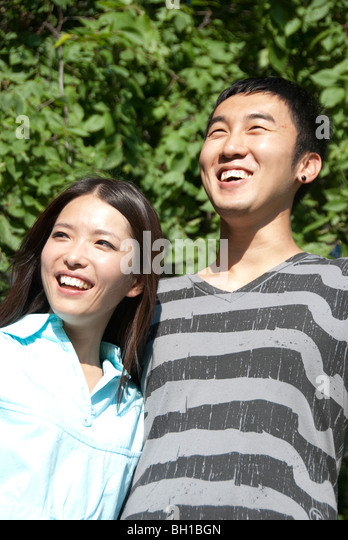 Young couple of Asian ethnicity in Assiniboine Park, Winnipeg, Manitoba, Canada - Stock Image