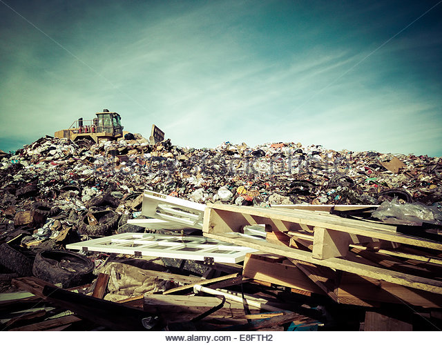 Garbage truck on landfill - Stock Image