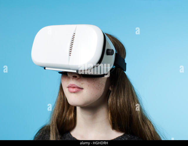Girl 12- 14yo wearing virtual reality VR Glasses - Stock Image