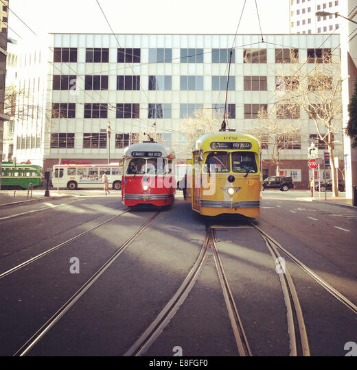 USA, California, San Francisco, Muni bus and F trains on Market - Stock Image