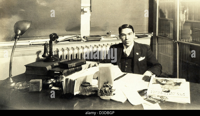 This 1930s photo shows a lawyer in his office in the Olympia Building on Purchase Street in New Bedford, Massachusetts. - Stock Image